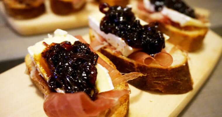 Serrano Ham and Brie Crostini with Sweet Onion Relish