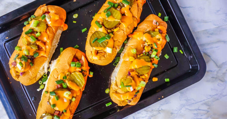 Gourmet Hot Dog with Bacon Corn Relish and Buffalo Style Cheese Sauce