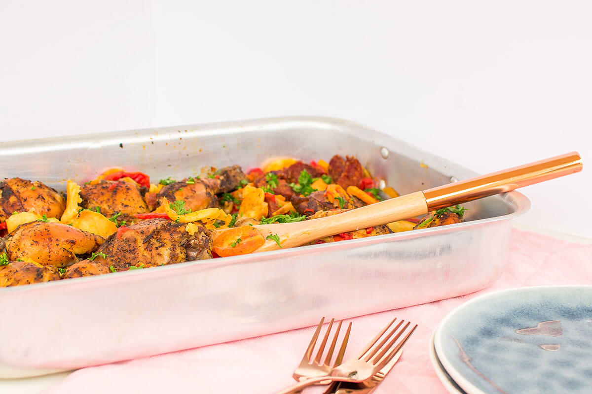 A colorful casserole dish with Spanish chicken.