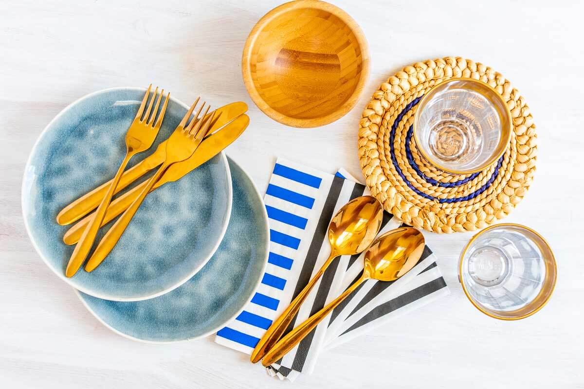 Flat-lay dinnerware essentials for entertaining at home.