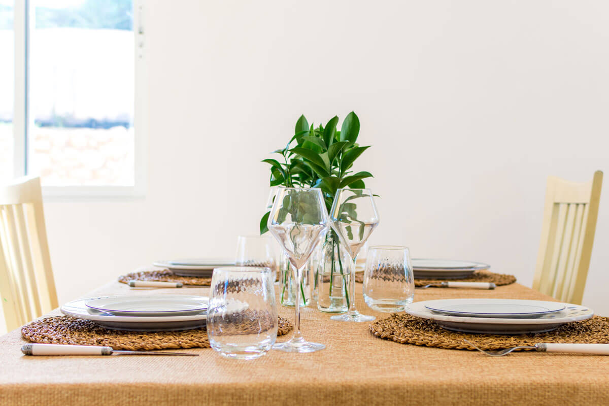A sideshot of a dinner party tablescape.
