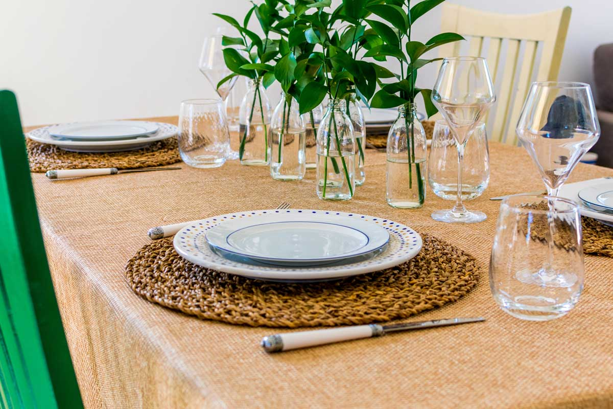 A shot of of a tablescape with two design plates and placemat.