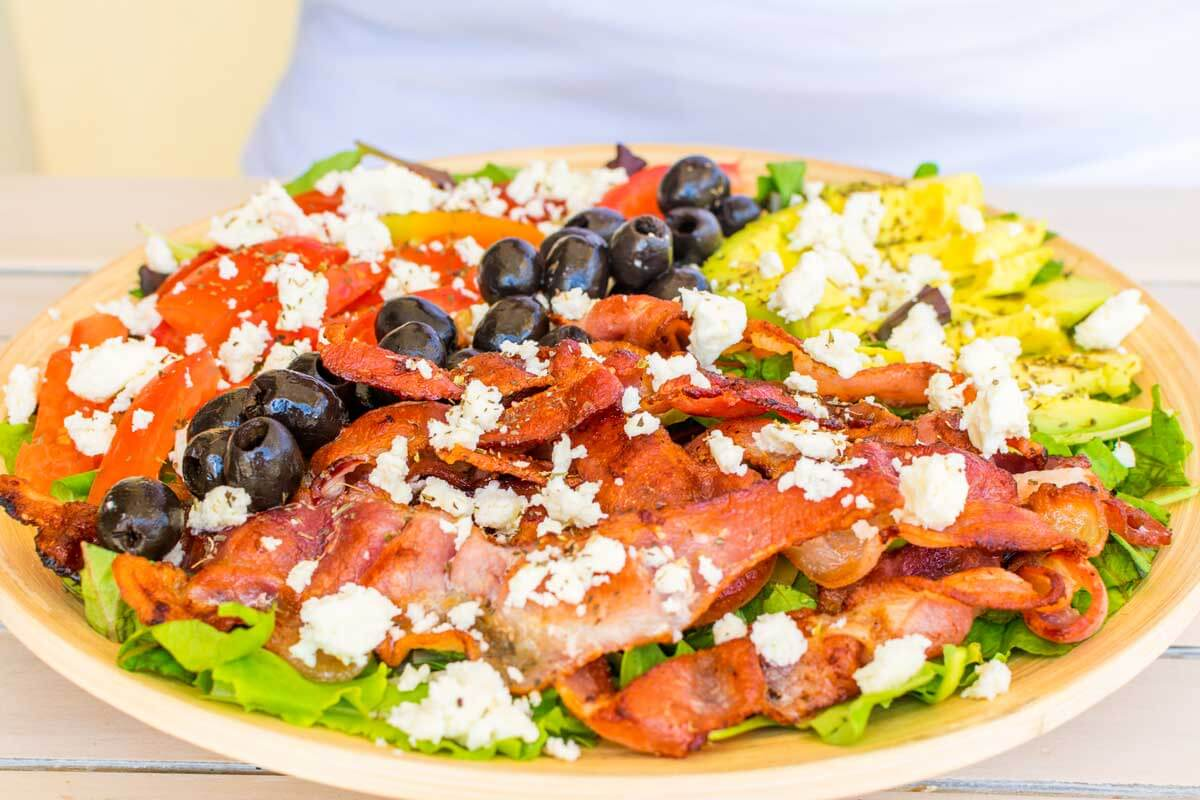 A front view of of the BLT salad with a white background.