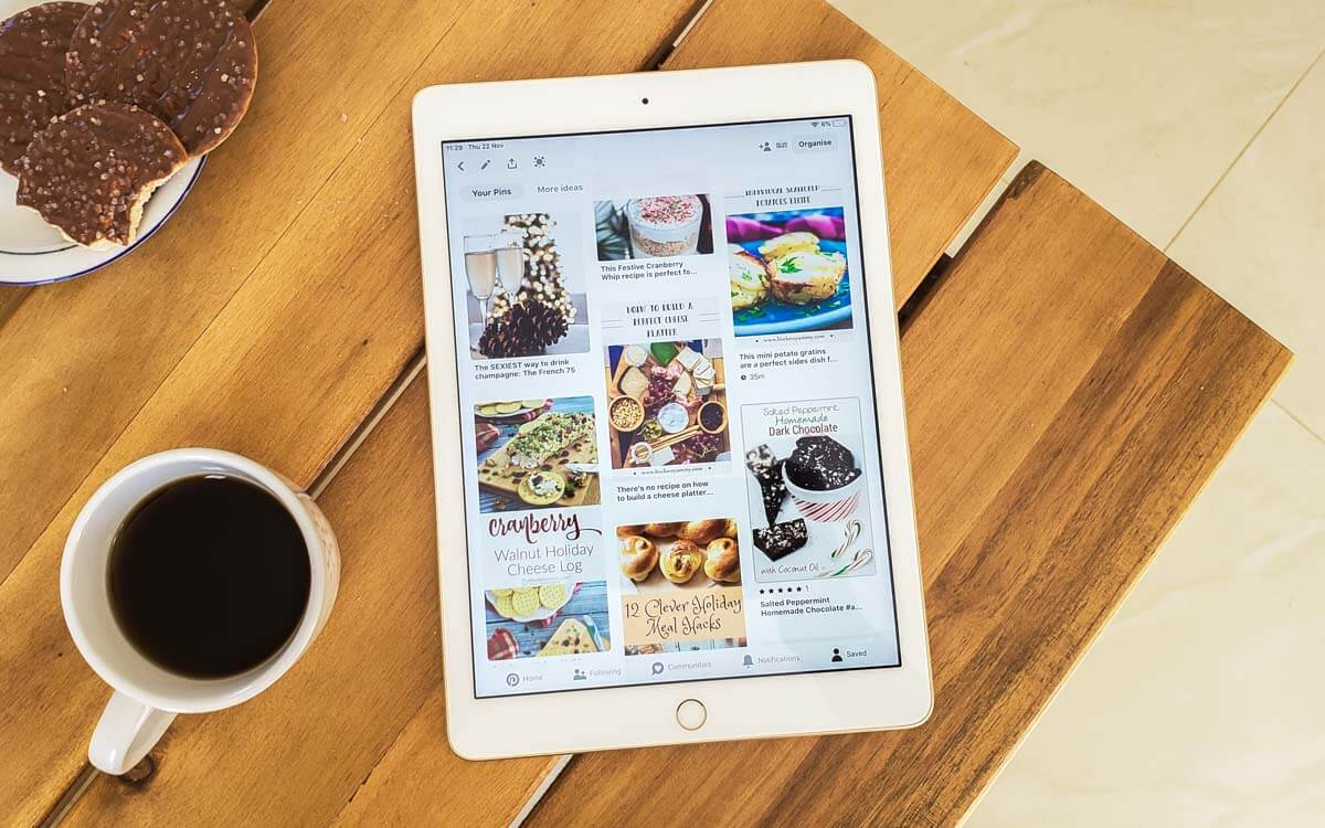 Flatlay of an iPad with Pinterest on it, coffee, and cookies.