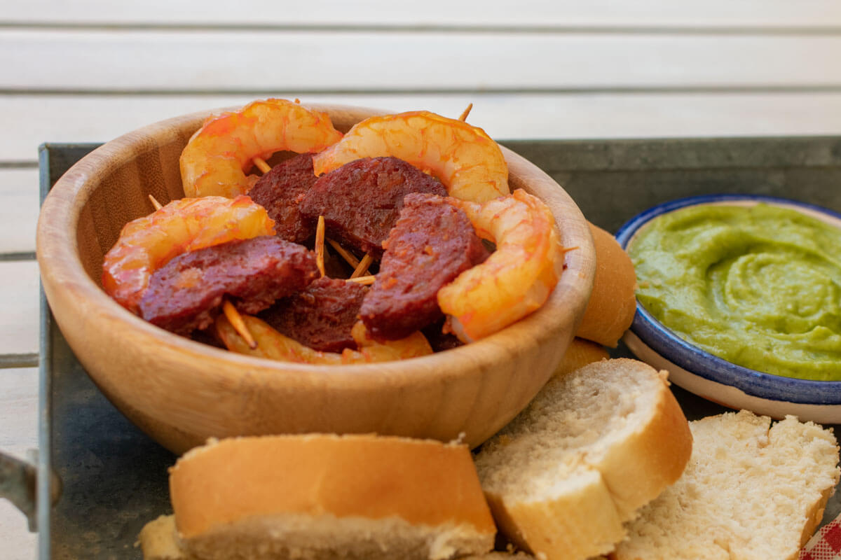 A bowl with shrimp-Chrorizo pinchos that is part of the Christmas appetizer platter.