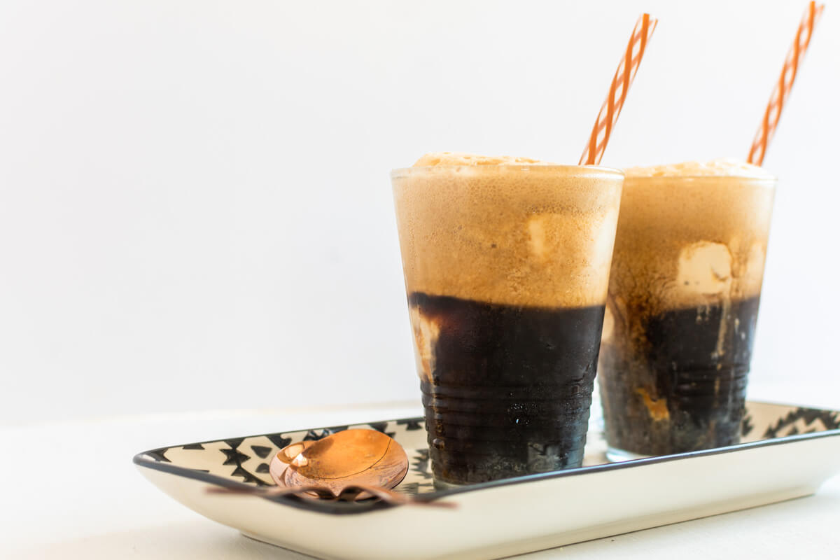 2 glasses filled with Guinness Float and 2 spoons in front.