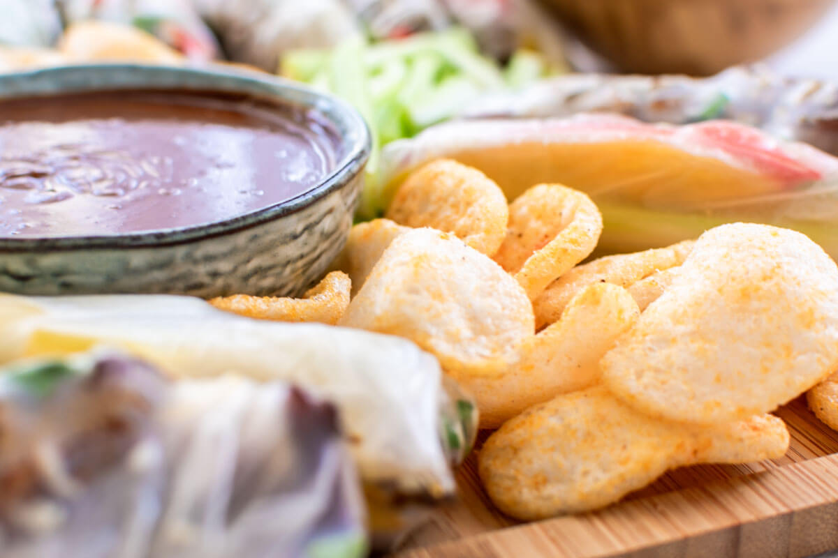 Praw crackers and peanut sauce on a summer roll platter.