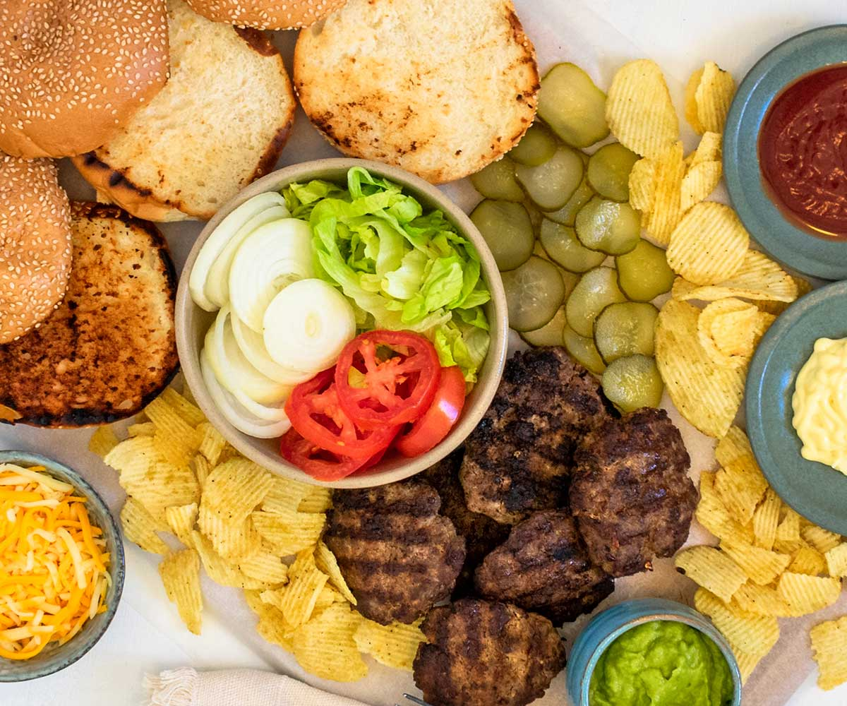 A close-up of the ingredients for a build-your-own burger platter.