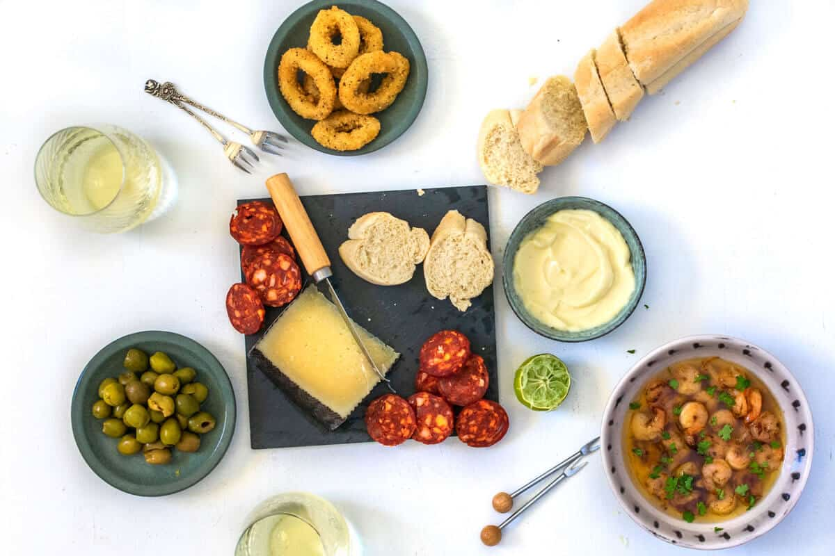 A Spanish tapas platter on a white background.