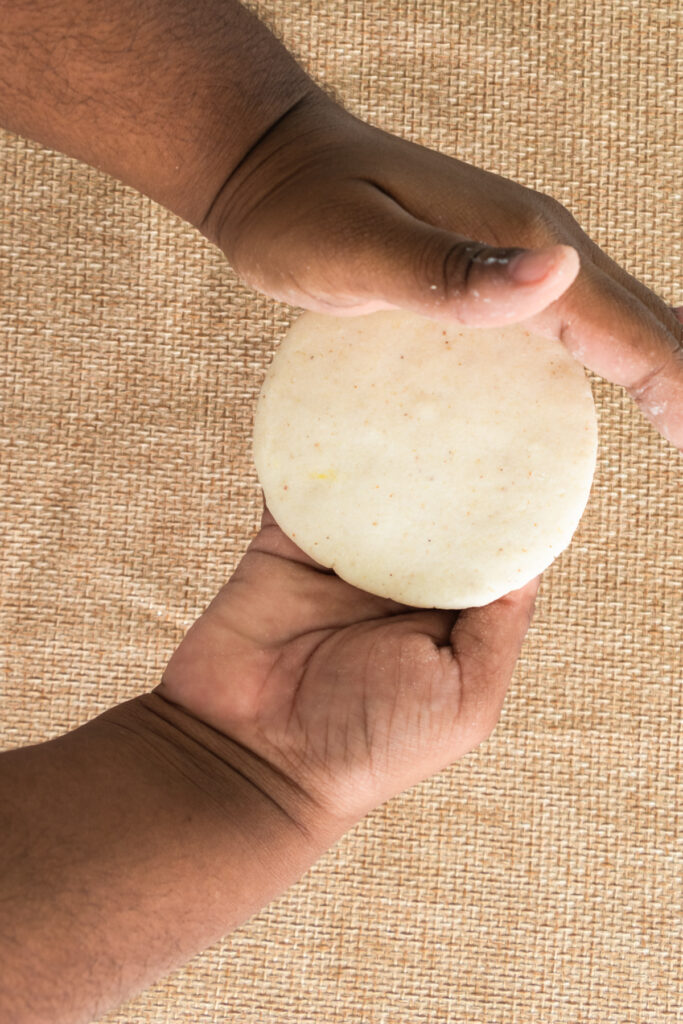 Shaping the dough of arepas