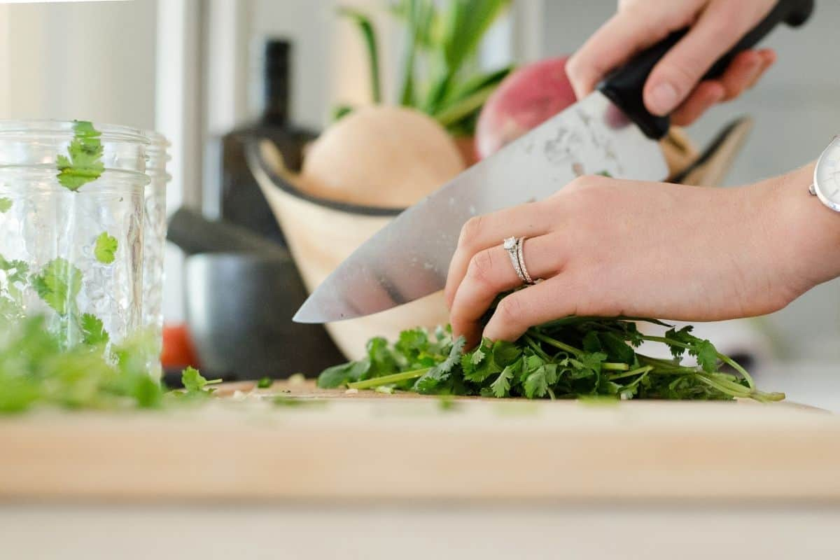 knife cutting fresh cilantro