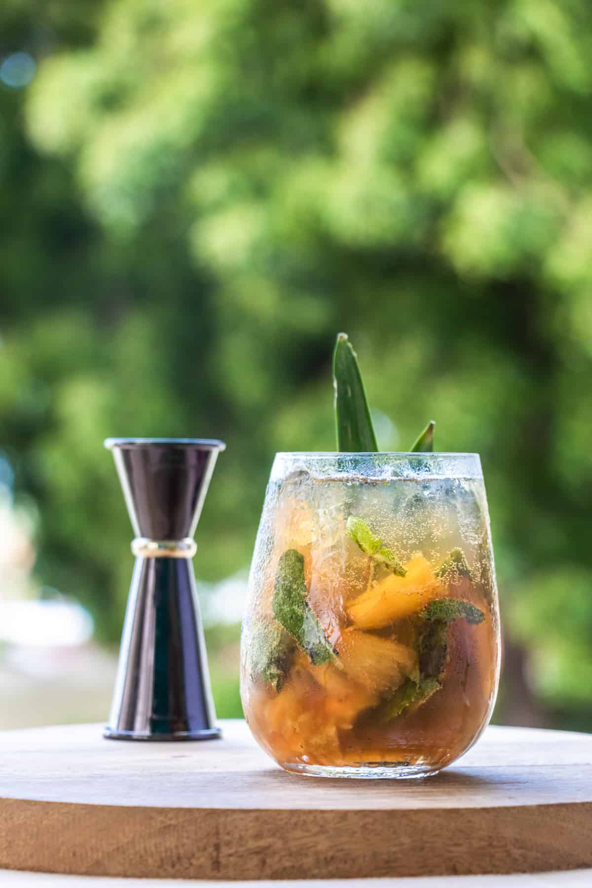 A glass of pineapple mojito