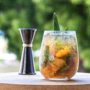 A glass of grilled pineapple mojito
