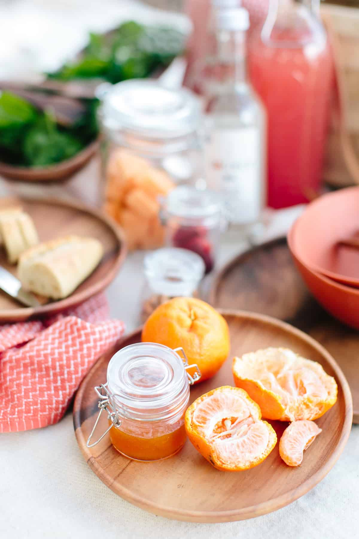 A table with jars of syrups and cocktail ingredients using mise en place technique at home